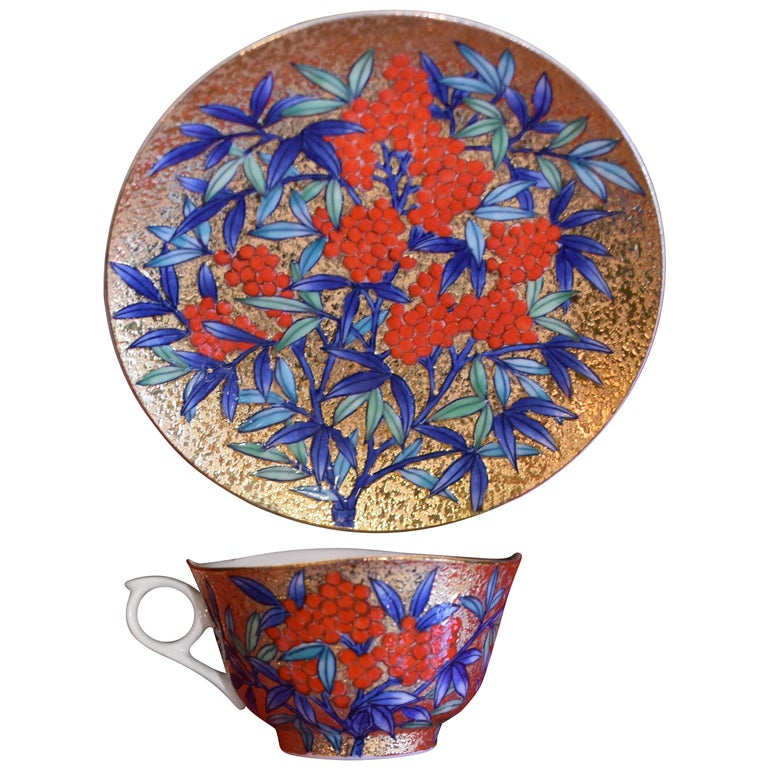 Gilded Japanese red Blue Porcelain Cup and Saucer by Master Artist For Sale