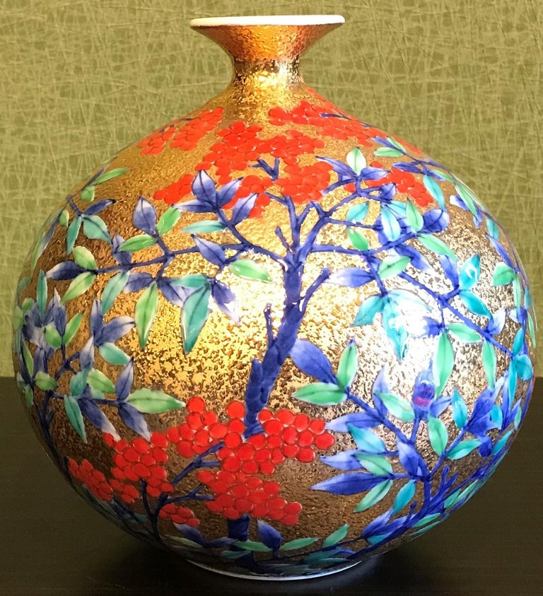 Contemporary Imari gilded porcelain vase, intricately hand painted on an attractive gilded ovoid shaped body with a delicate lotus-blossom lip. This piece is the work of highly respected award-winning master porcelain artist from the Imari-Arita