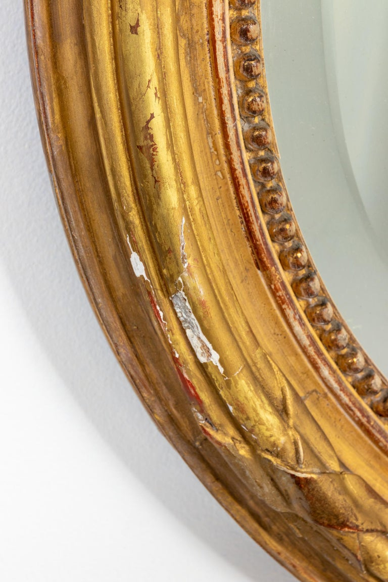 Appliqué Gilded Oval Mirror with Bow Detail For Sale