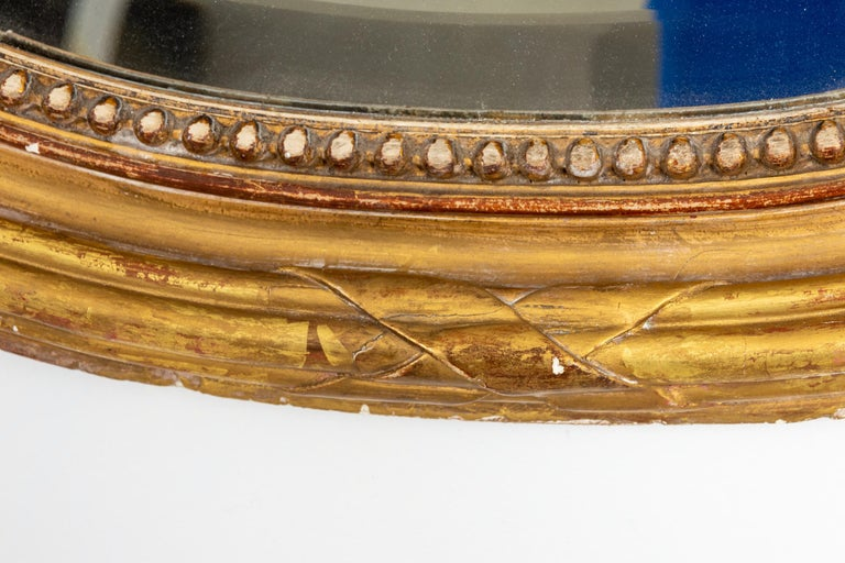 19th Century Gilded Oval Mirror with Bow Detail For Sale