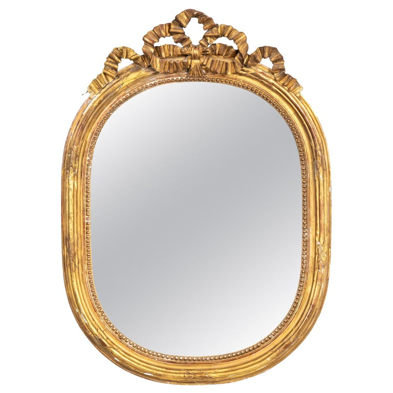 Gilded Oval Mirror with Bow Detail For Sale
