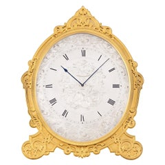 Gilded Oval Strut Clock by Thomas Cole of London