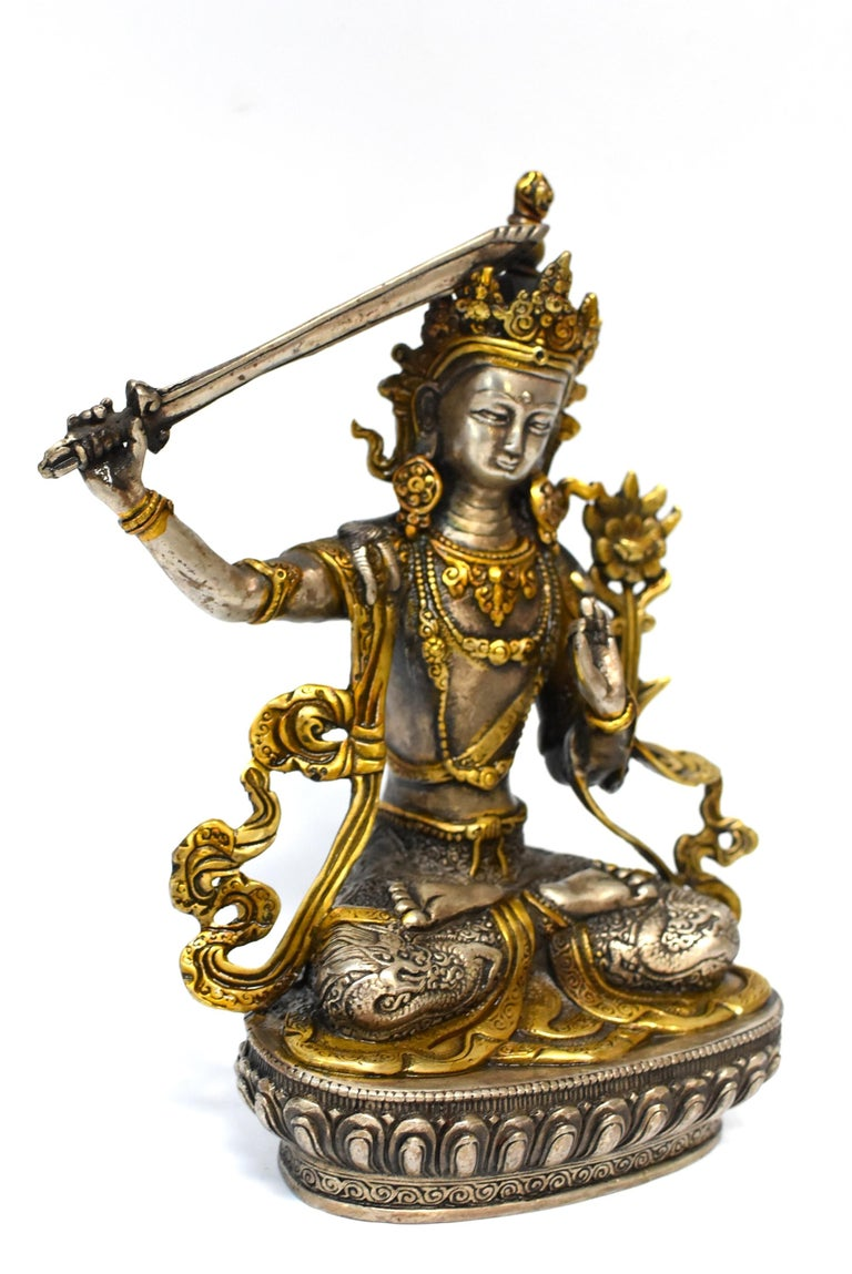 A beautiful statue of Tibetan Bodhisattva Manjushree. Legend has it that he cuts water with the sword to divide the water resource to irrigate dry valleys. Manjushree is the God of Wisdom. In this statue he wears a high crown and embossed skirt