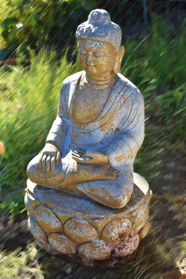 A beautiful hand carved statue of Buddha with golden face in the Tang style. Buddha is seated on a double lotus base, hands forming Bhumisparsha Mudra touching the earth symbolizing attaining enlightenment, dressed in a robe draping over shoulders