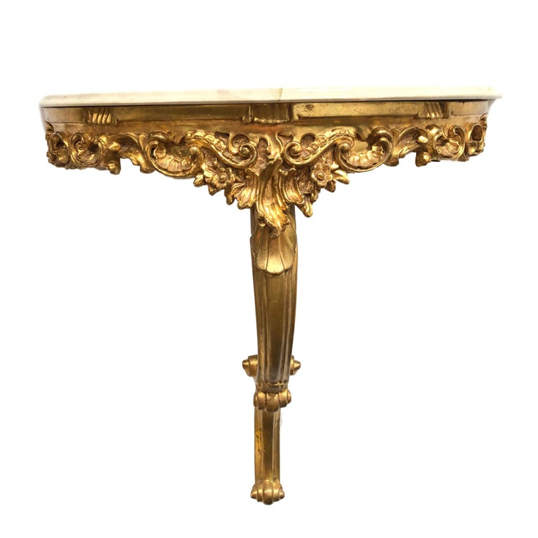 Beautiful gilded tole wooden wall shelf Hollywood Regency style with marble plate, vintage, Italy, 1960s. Nice addition to any room or hall entry.