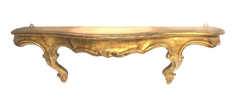 Beautiful petite gilded tole wall shelf Hollywood Regency style, vintage Italy, 1960s. Nice addition to any room or hall entry.
