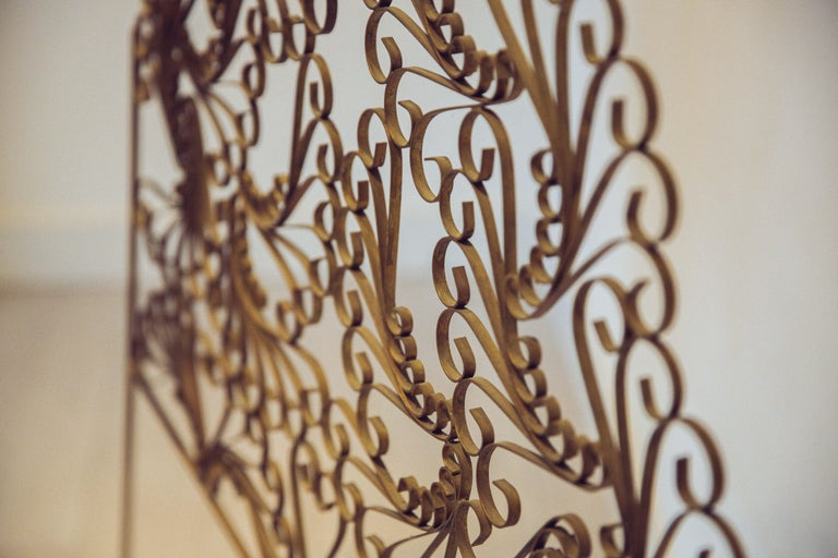 Extraordinaire and unique gilded wrought iron vintage headboard. Elegant swirls that is inspired by the iconic peacock chairs. It would be a perfect fit for a single bed in the guest room or kidsroom.
