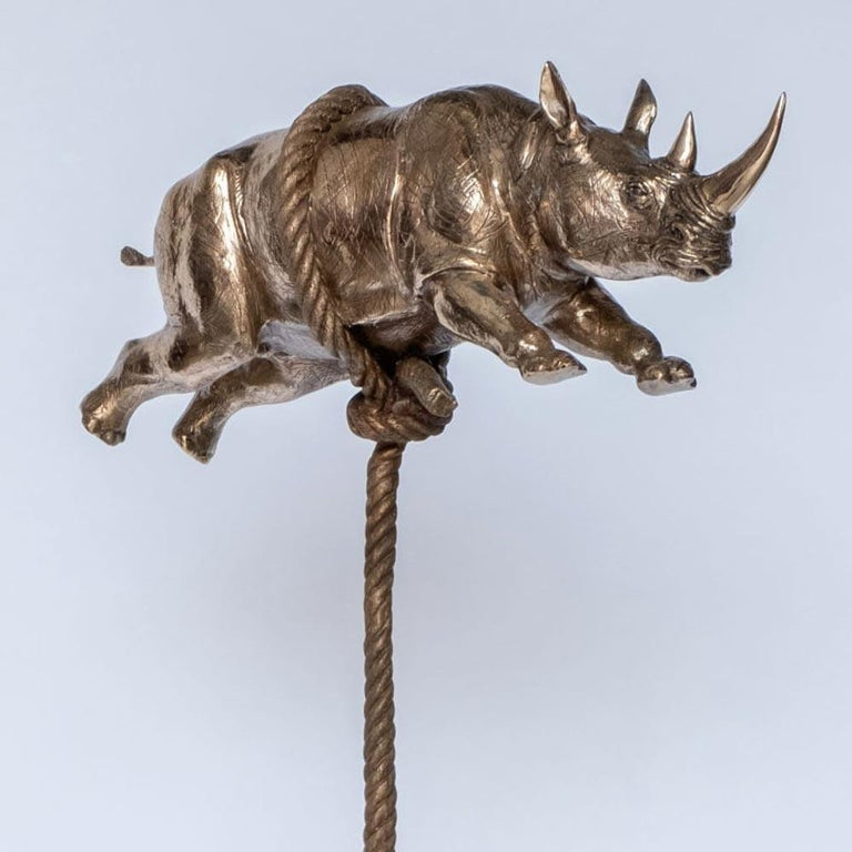 Title: Gold Rhino Flying (Gold rhino on long bronze rope) Authentic bronze sculpture Limited Edition  World Famous Contemporary Artists: Husband and wife team, Gillie and Marc, are New York and Sydney-based contemporary artists who collaborate to