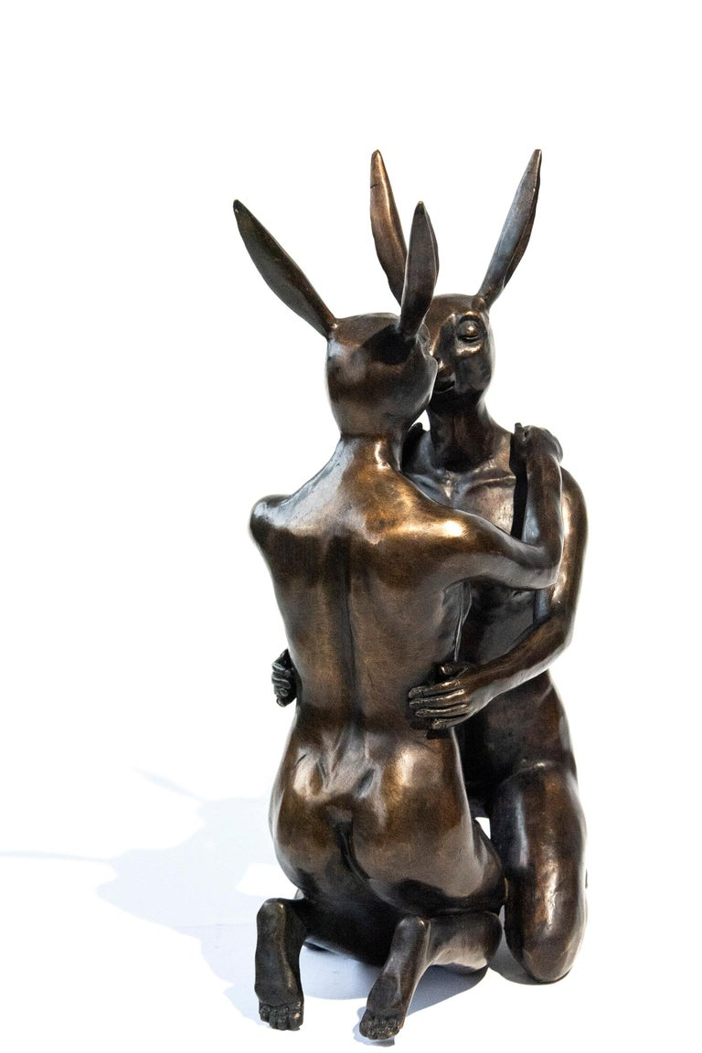The narrative of love takes many forms in this bronze Gillie and Marc sculpture. Sculpture weighs approx. 12.5 lbs. The artists' names and edition number, 12/30, are stamped into the sculpture and painted gold.   The Australian artistic duo Gillie