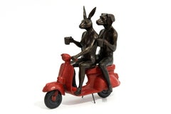 Their morning ride started with coffee and a kiss - playful, bronze sculpture