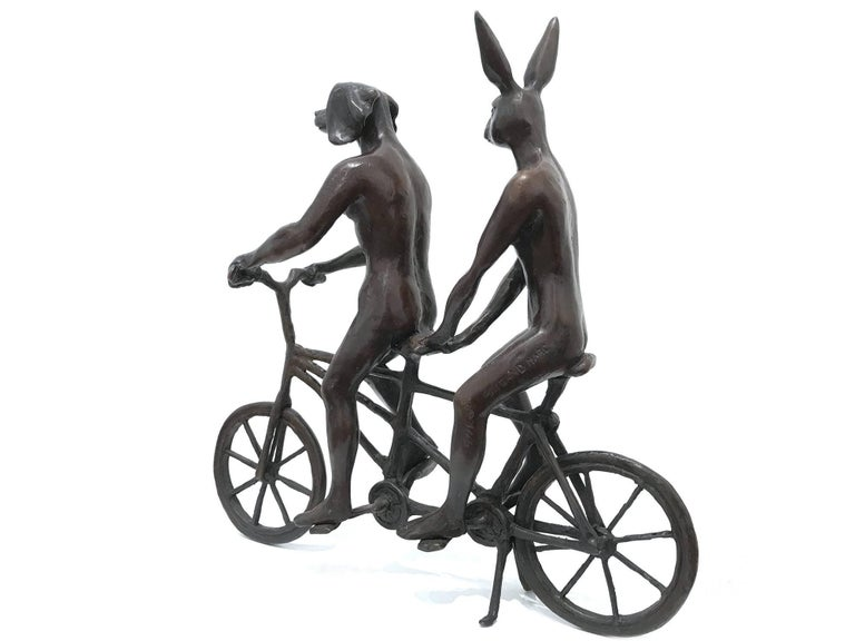 A whimsical yet very strong piece depicting the Rabbit and Weim from Gillie and Marc's iconic figures of the Dog/Bunny Human Hybrid, which has picked up much esteem across the globe. Here we find these characters riding together on a bicycle through