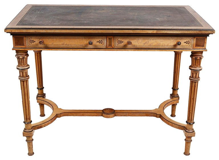 A very good quality 19th century Satin Birch inlaid library writing table, having an inset leather top, two frieze drawers, mahogany lined, stamped 'Gillows', raised on wonderful turned tapering carved and fluted legs, united by a stretcher between.