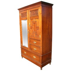 Gillow's of Lancaster, an Aesthetic Movement Walnut Armoire Wardrobe Compactum