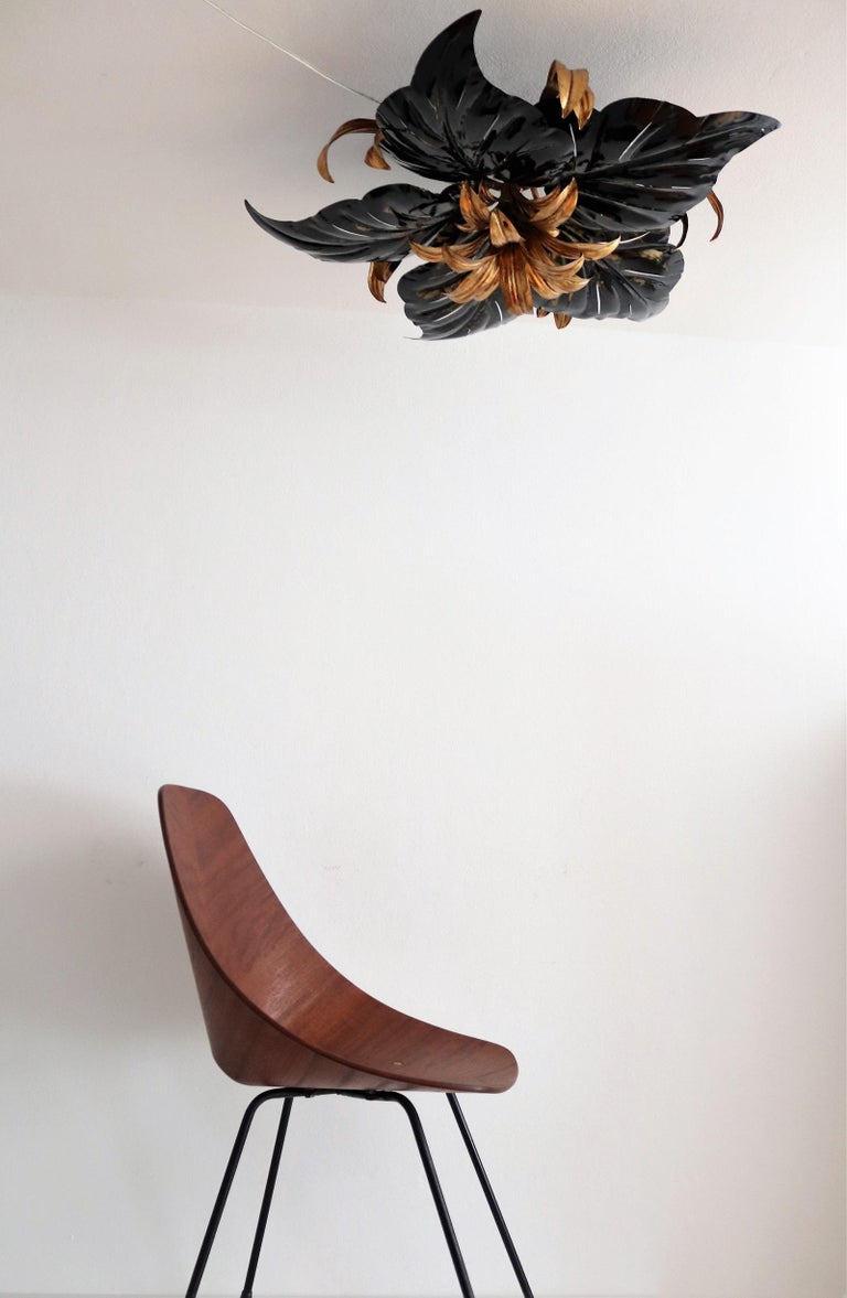 Gorgeous and big flush mount ceiling light with strong big leaves in black and gilt metal. Made in Italy by Kogl in the 1970s. This ceiling light is a gorgeous eye-catcher and has a beautiful two-color combination. Under the leaves are hidden five