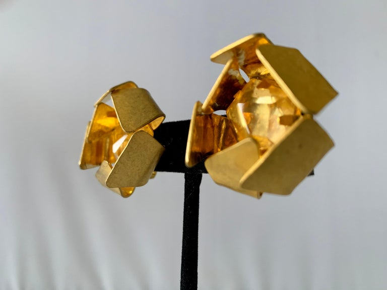 Contemporary gilt metal geometric rock crystal clip-on statement earrings by Herve Van der Straeten, Paris. Signed on the back.
