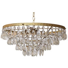 Gilt Brass and Crystal Mid century Modern Chandelier by Palwa with 4 Tiers