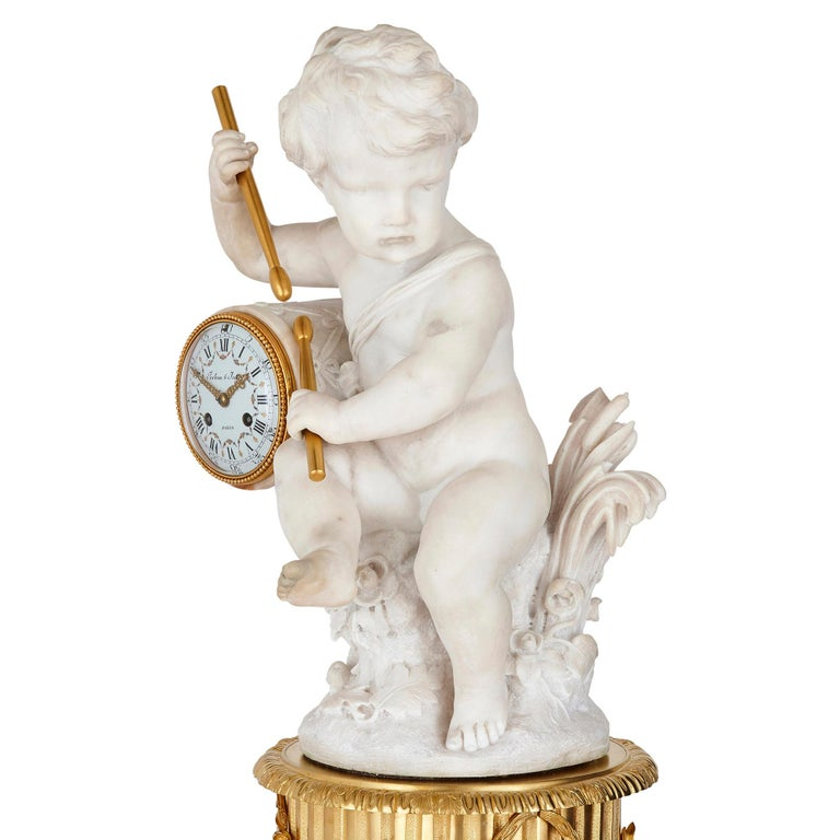 Gilt bronze and marble cherub mantel clock by Raingo Frères French, late 19th century Measures: Height 69cm, width 31cm, depth 31cm  This superb mantel clock, crafted from ormolu and white marble, is by Festeau le Jeune and Raingo Frères. The