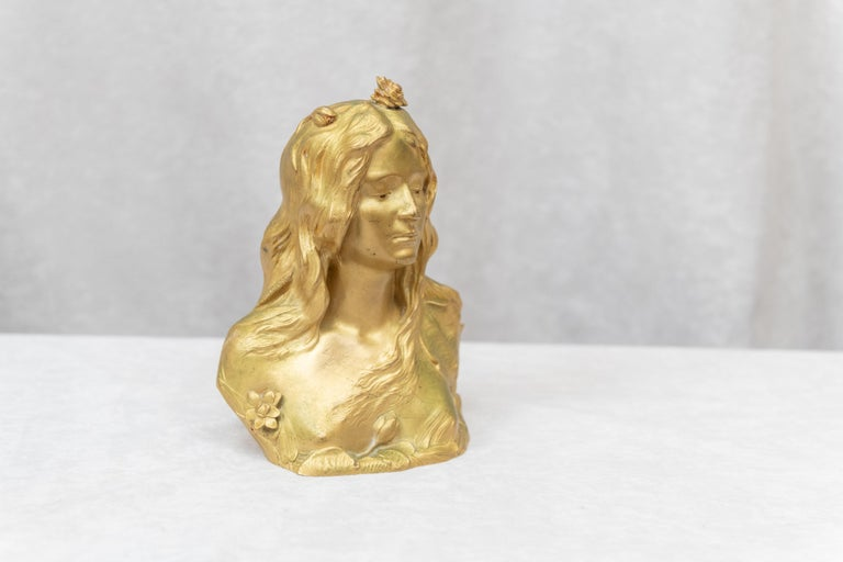 This is an exceptional example of the beauty of the art nouveau movement. It has all the qualities of what art nouveau lovers look for. The back to nature look with the flowing hair, the flowers, and even the back of the bronze is staying true to