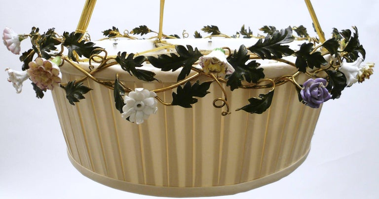 This charming Caldwell floral motif fixture features hand-painted porcelain flowers with gilt ribbons and bow knots. The original shade frame has been newly recovered in ivory silk.