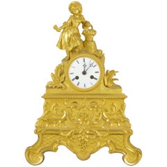 Gilt Bronze 19th century Mazntel Clock Representing a Girl with a Flower Basket