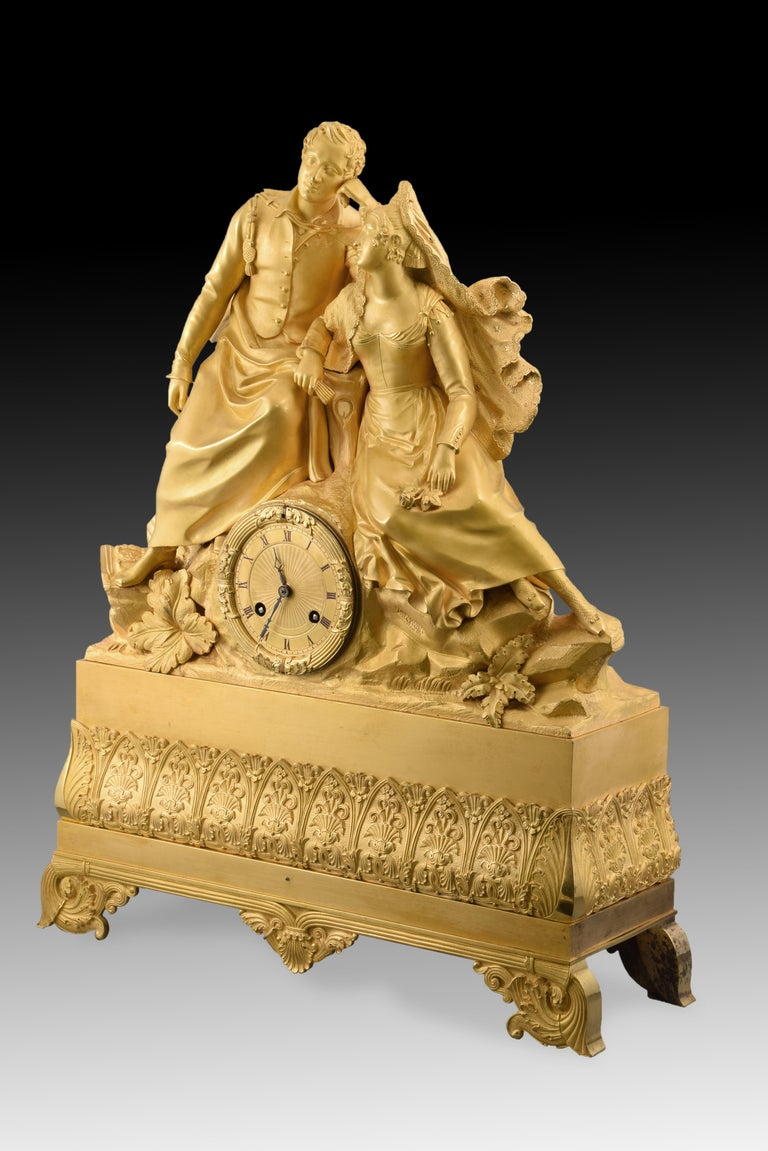 Neoclassical Gilt bronze mantel clock, Couple. 19th century. In working order. For Sale