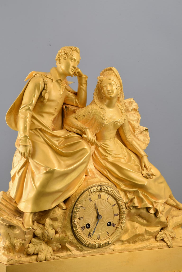 Bronze Gilt bronze mantel clock, Couple. 19th century. In working order. For Sale