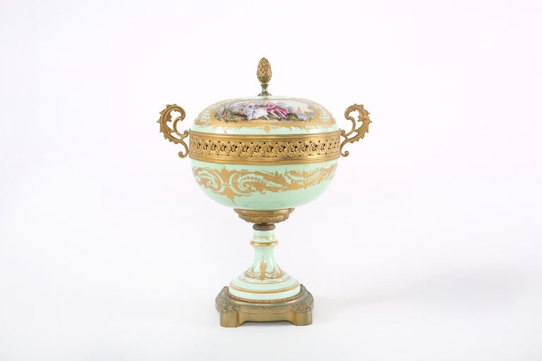 19th century gilt bronze mounted porcelain covered decorative urn with interior / exterior painted design details. The piece is in great antique condition with wear consistent with age / use. Maker's mark undersigned. The urn stands about 15-1/4