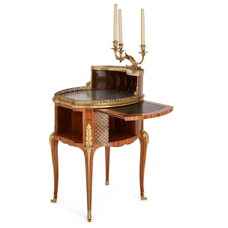 This writing table was designed by one of the leading craftsmen of the 19th century, Henry Dasson (1825-1896). Dasson began his career as a bronze sculptor, and only later became an ébéniste (cabinetmaker). Because of this, Dasson's furniture is