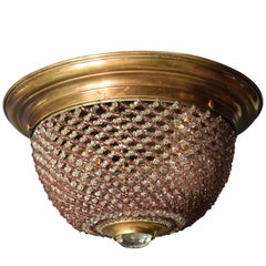 Gilt bronze pendant with two tone beaded woven dome