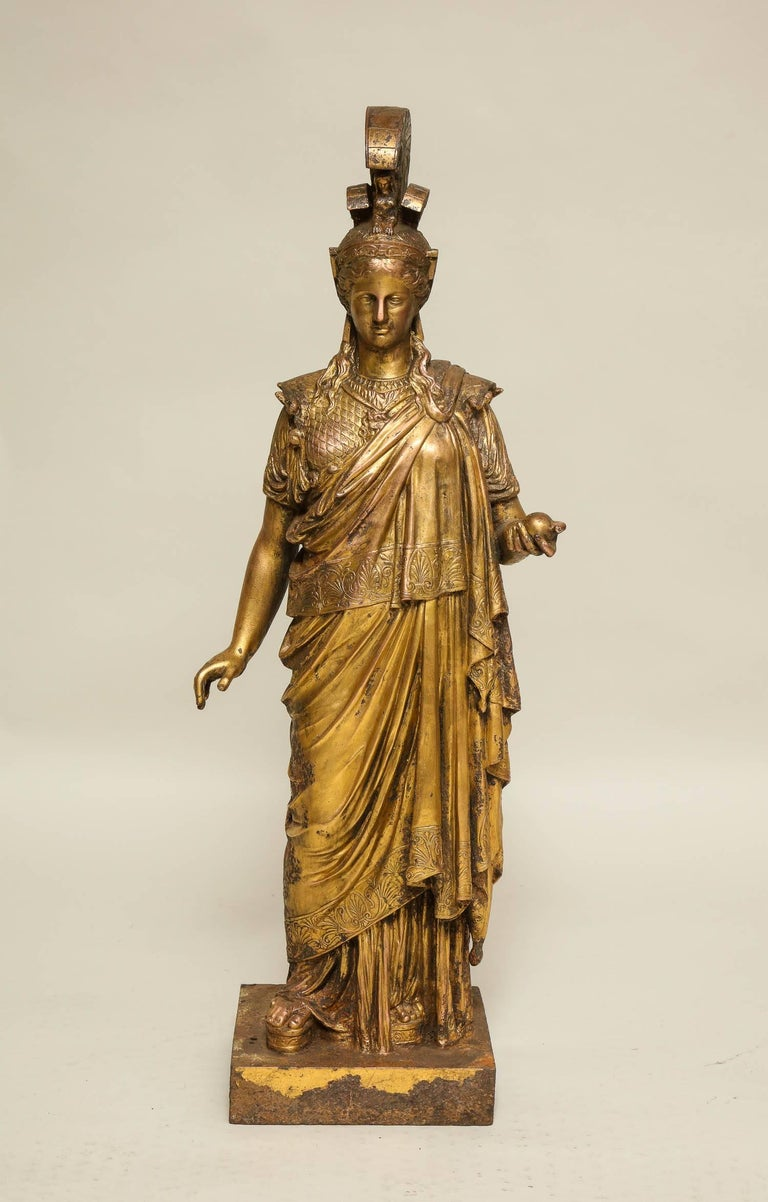 Very fine neoclassical gilt cast iron sculpture of Athena, similar to an example outside Vienna's Palace of Justice, but most unusually cast in very finely detailed cast iron, then copper plated and finally gilded. The surface pitted from use