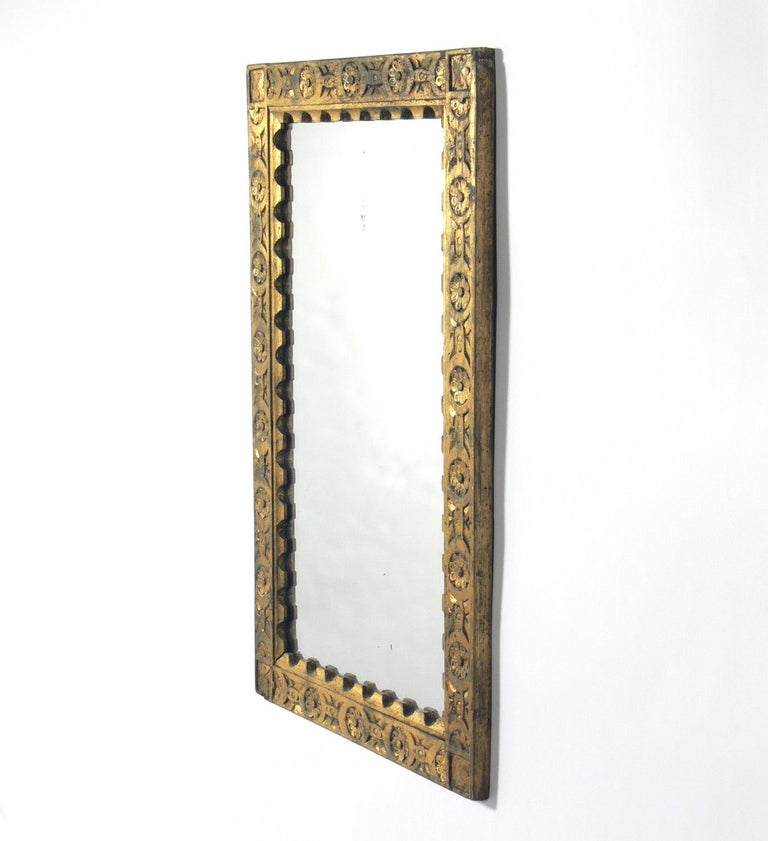 Gilt hand carved Spanish or Italian mirror, at least 1930s, possibly much earlier. Retains wonderful original distressed patina to both the giltwood frame and the mirror.