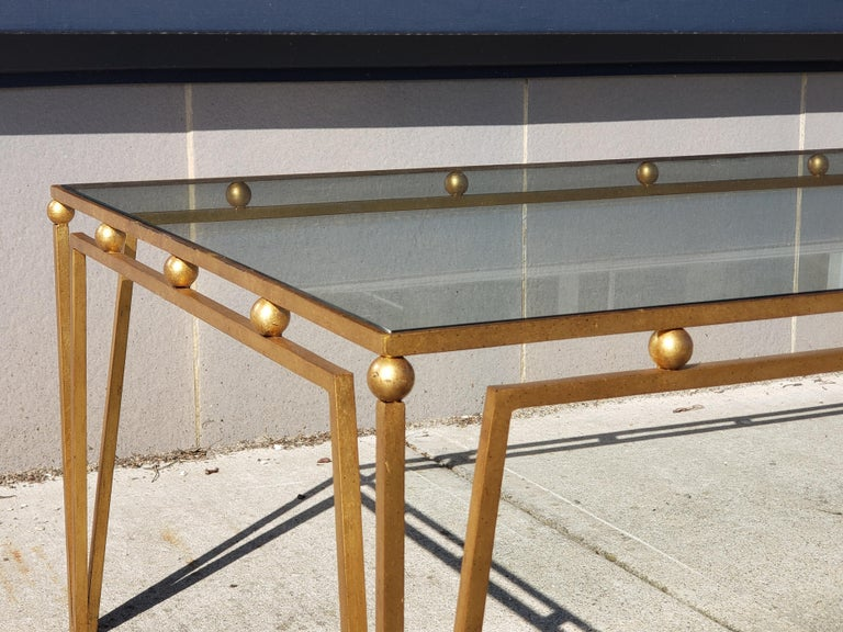 Stunning gilt iron coffee table after Marc du Plantier. Wonderful size and versatile lending itself to both modern and traditional interiors.