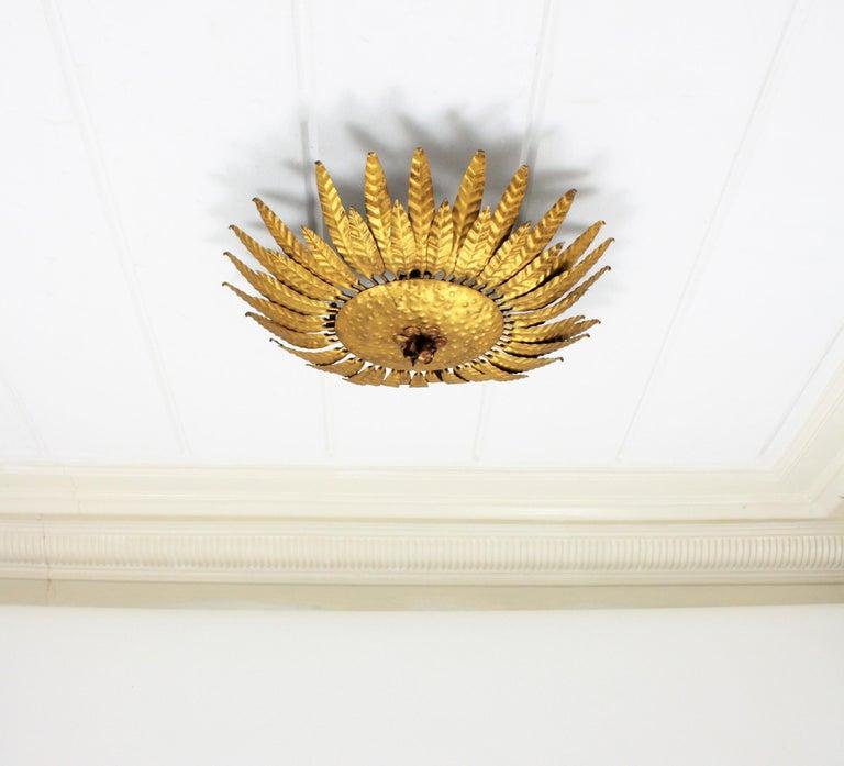 Spanish Gilt Iron Flower Burst Sunburst Ceiling Flush Mount or Wall Light, Spain, 1960s For Sale