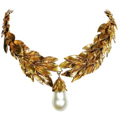 Gilt 'laurel' leaf, with baroque pearl drop necklace, Yves Saint Laurent, 1980s.