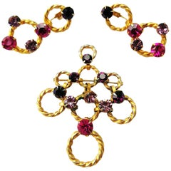 Gilt metal, fuschia and amethyst paste brooch/earrings, Christian Dior, c1954