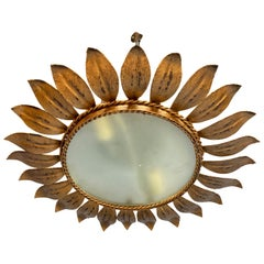 Gilt Metal Sunburst Ceiling Fixture with Radiating Leaf Design