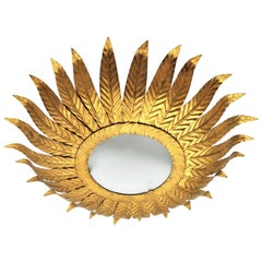 Gilt Metal Sunburst Light Fixture with Frosted Glass / Sunburst Wall Mirror