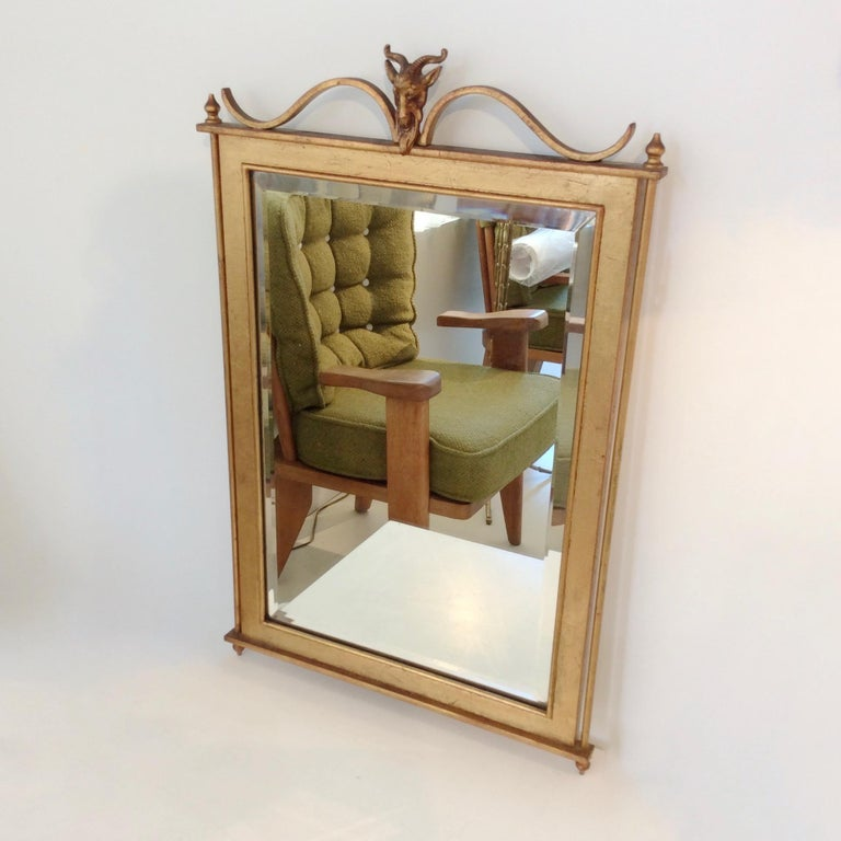 Nice gilt metal wall mirror, circa 1940, Maison Jansen attributed, France. Gilt metal frame, beveled mirror. Dimensions: 69 cm H, 44 cm W, 2 cm D. Good original condition. We ship worldwide.