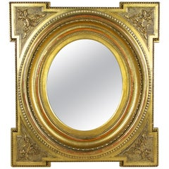 Gilt Oval Biedermeier Wall Mirror with Stucco Works, Austria, circa 1860