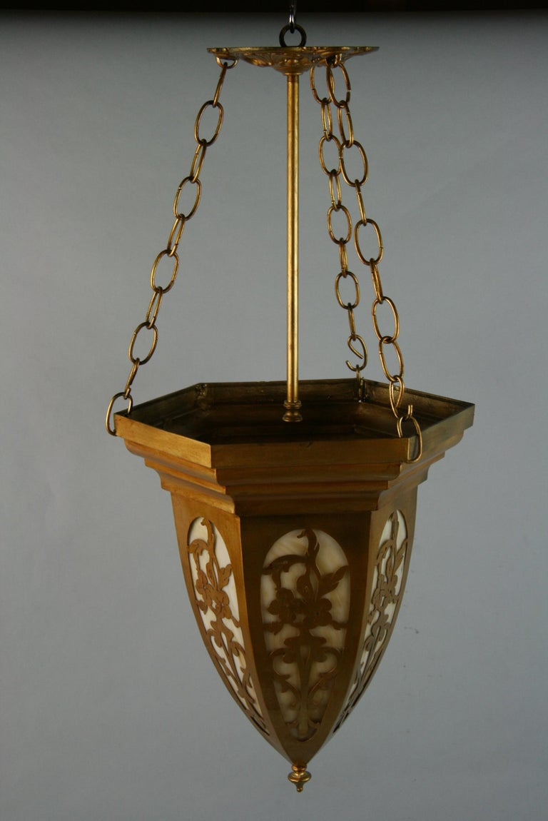 3-687 pierced metal with bent glass pendant with one 100 watt max Edison based bulb Rewired.