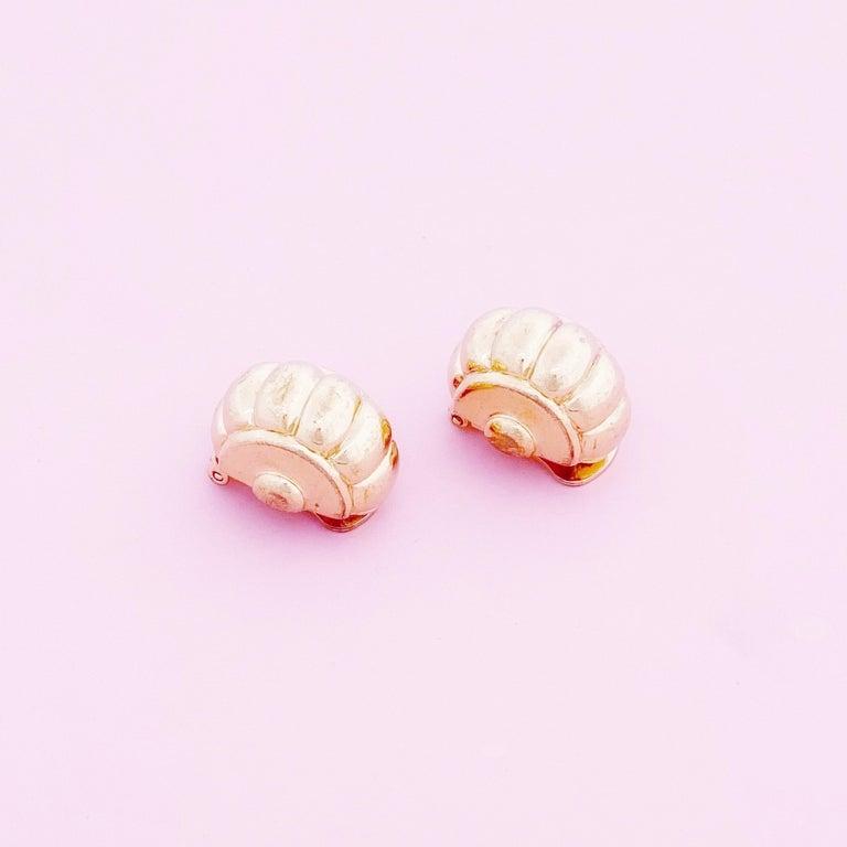- Vintage item  - Each earring measures .9