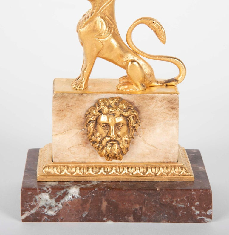 Empire Gilt Sphinx Themed Candlestick on a Stepped Marble Base For Sale