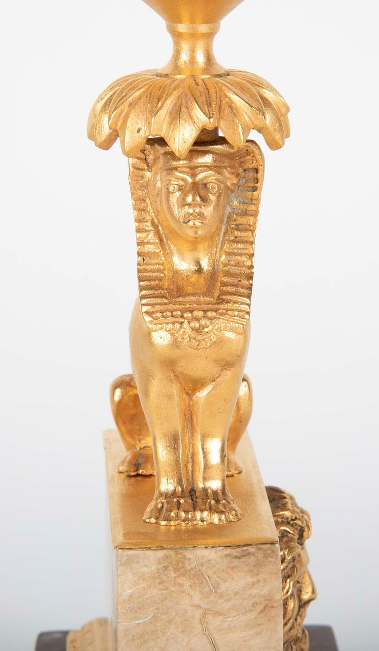 Bronze Gilt Sphinx Themed Candlestick on a Stepped Marble Base For Sale