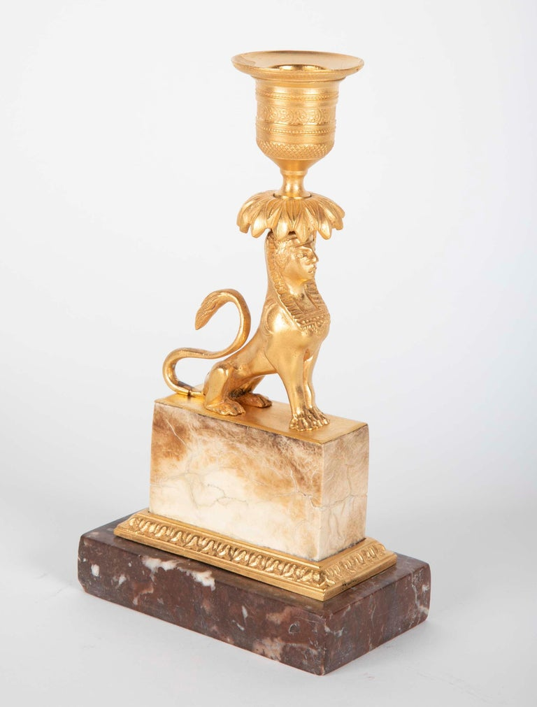 Gilt Sphinx Themed Candlestick on a Stepped Marble Base For Sale 1