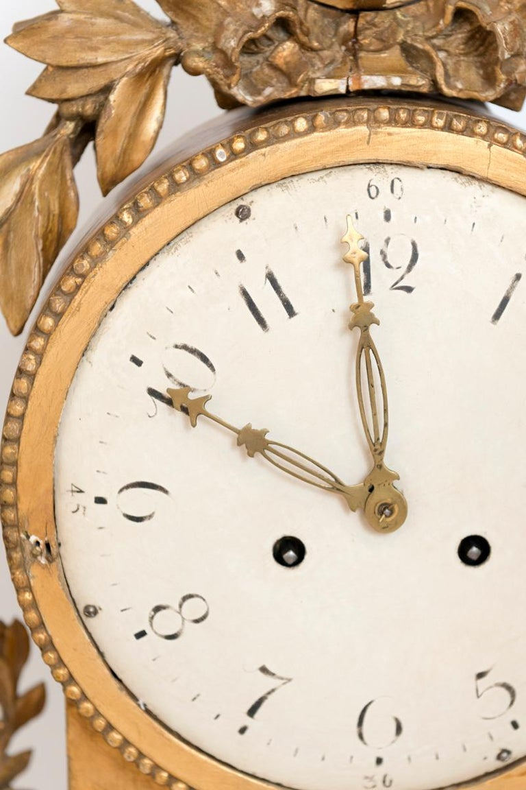 A gilt Swedish cartel wall clock.