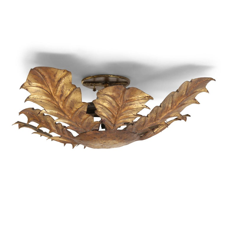 Gilt tole acanthus flush mount fixture for your ceiling or wall. This vintage Spanish light dates to about 1930-1960 (Barcelona) and is newly wired for use within the USA. Accommodates two candelabra-size bulbs. Ready to install.