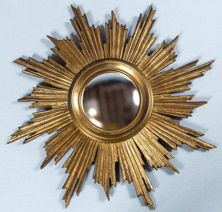 Giltwood Sunburst Mirror, France, mid-20th century. Original convex glass. Hand carved wood frame with original gilt finish.