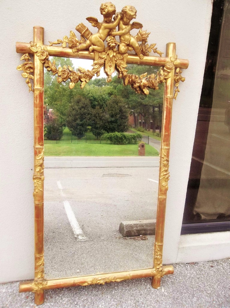 Giltwood Faux Bamboo Mirror with Cherubs or Putti Crest with Floral Garlands In Good Condition For Sale In Nashville, TN