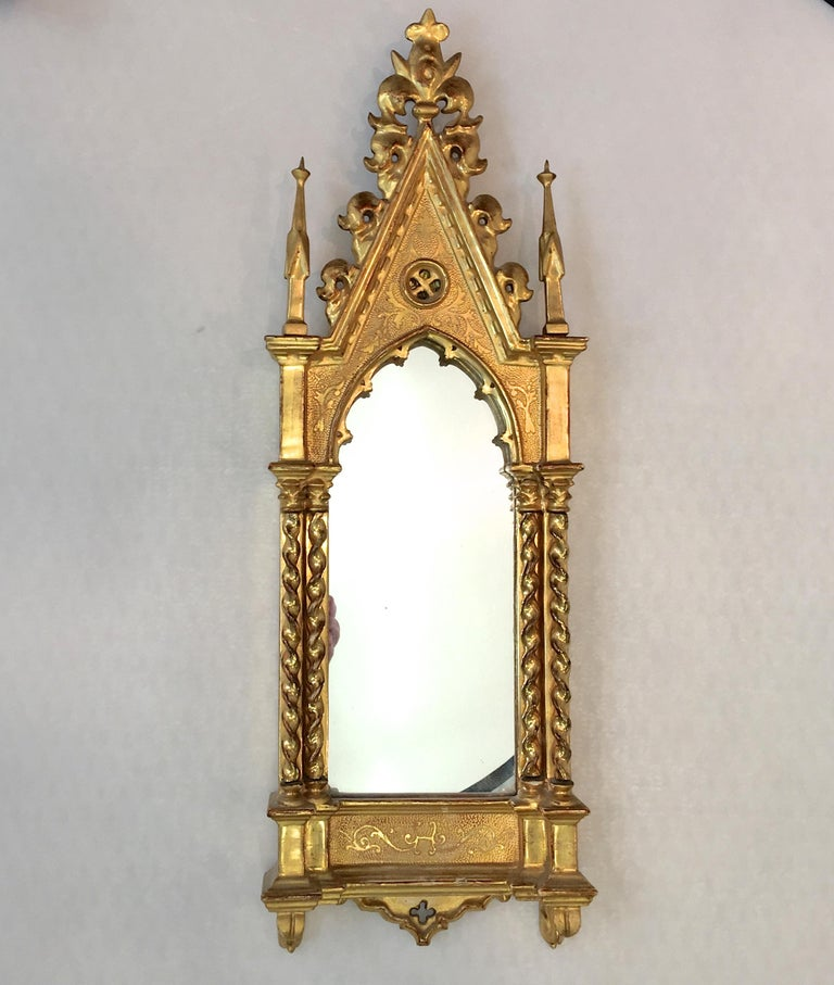 A mirror in water giltwood and gesso pierce carved Italian cathedral frame. Grand Tour, circa 1850. Originally would have held an ecclesiastical painting on board of an angel detail after Fra Angelico's Linaioli altar piece, Museo di San MarCo,