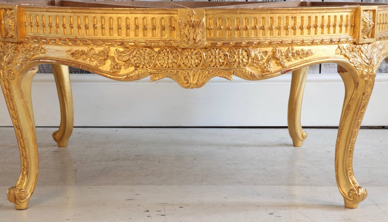 Hand-carved, giltwood round low end table. we can supply a marble top on quotation if required.